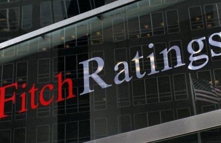 Fitch понизило прогноз роста мировой экономики из-заторговой войны СШАиКитая